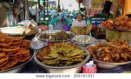 A Vendor Selling Foods On Street