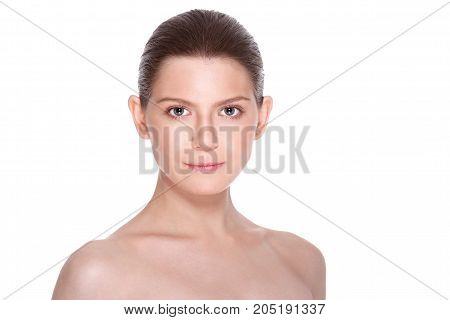 Beautiful Young Woman with Clean Fresh Skin. Facial treatment. Cosmetology, beauty and spa. on a white isolated background