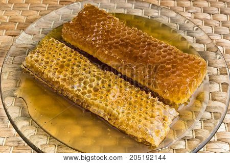 Two pieces of honeycomb on natural matting