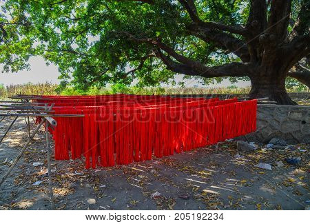 Colorful Fabric Hanging To Dry After Dye
