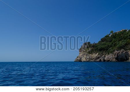 blue sea and the rocks of Corfu, Greece