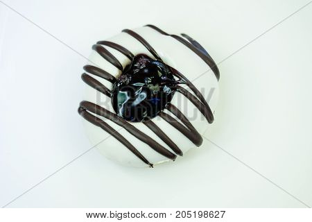 Donut with sprinkles isolated on white background.
