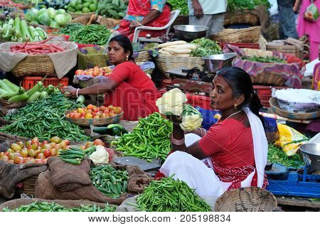 UDAJPUR INDIA - 28 FEBRUARY 2010: Indian Colorfully women seling the vegetables on the street in India