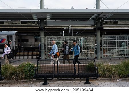 Hoboken NJ USA -- September 19 2017 -- Commuters walking by the train station. Editorial Use Only.