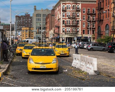 Hoboken NJ USA -- September 19 2017 --Yellow Taxi cabs are lined up outside the Hoboken bus and train terminal. Editorial Use Only. Editorial use only.