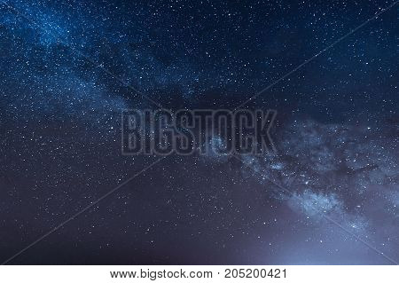 Milky Way. Colorful night landscape with bright milky way starry sky and hills in summer.