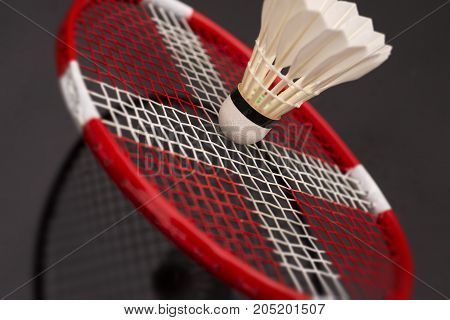 Badminton racket with Danish flag and shuttlecock closeup.