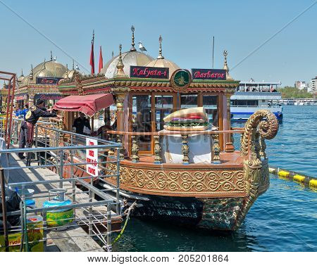 Istanbul Turkey - April 25 2017: Traditional fast food bobbing boat serving fish sandwiches at Eminonu with chefs preparing meals