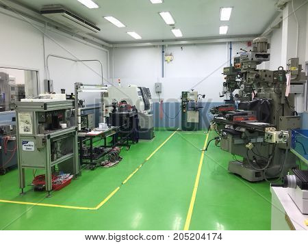 AYUTTHAYA THAILAND 22 SEP 2017: An empty room of the interior workshop with CNC machine in Hi-tech industry park Thailand