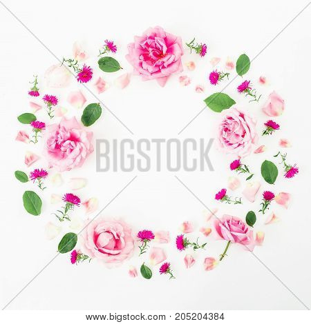 Found frame with pink flowers, roses and leaves on white background. Flat lay, top view. Frame background