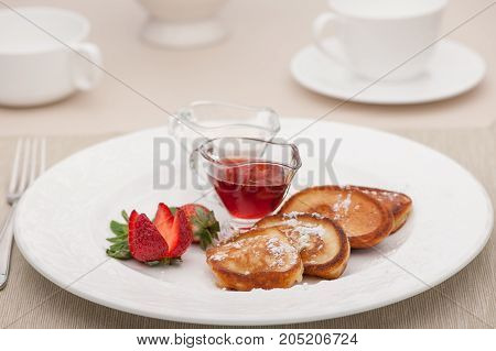 Breakfast Served With Toast And Fried Bread