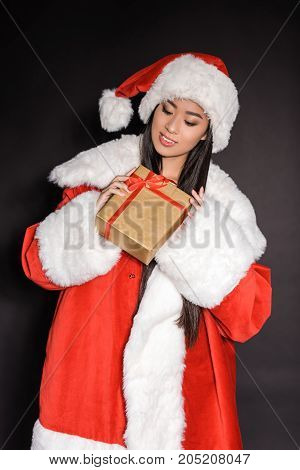Woman In Santa Costume Holding Present