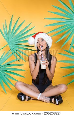 Woman In Swimsuit Drinking Milkshake