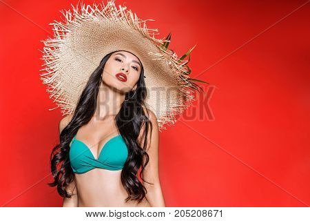 Asian Woman In Swimsuit And Straw Hat