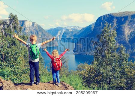 happy little boy and girl travel in Norway, active family travel