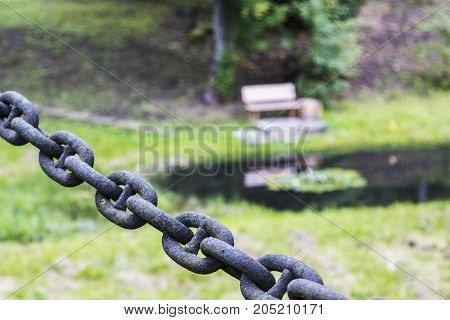 very old rusted chains on bridges and streets
