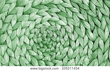 Green Color Straw Mat Surface With Round Pattern.