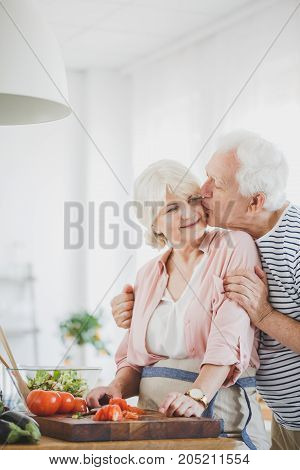 Grandpa Kisses Grandma On The Cheek