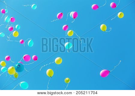multicolored balloons in the blue sky for background