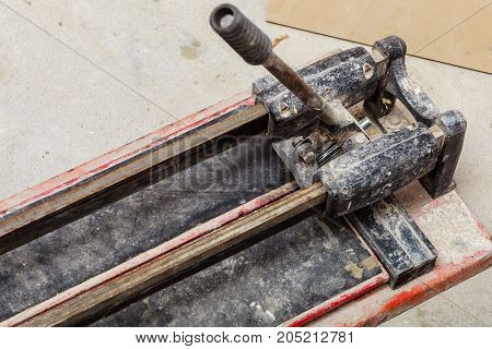 Industrial objects concept. Detailed close up of cutting tiles tool manual tile cutter.