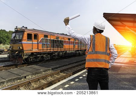 Engineers business men.Railway industry in the city with Twilight