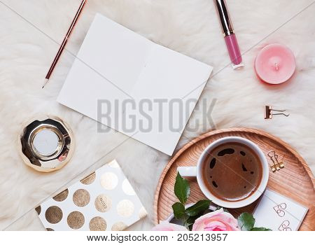 Empty Notepad, Coffee Roses And Other Accessories On The Cozy Fur Background, Top View.
