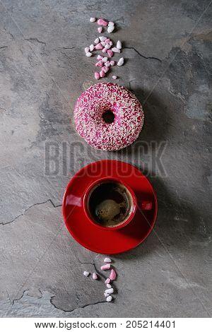 Pink Glazed Donut With Coffee