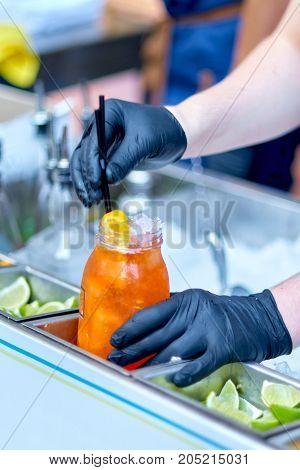 Barmen Preparing A Cocktail Drink Aperol Spritz On The Street.