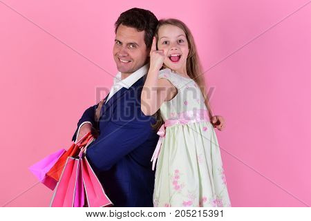 Girl And Man With Excited Faces Stand Back To Back