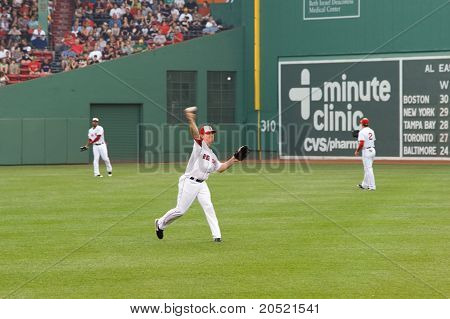 Boston - May 30: Red Sox Right Fielder #7 J.d. Drew Warms Up Before Memorial Day Game Against The Re