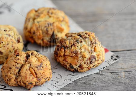 Home walnuts biscuits on a wooden background. Sugary baked biscuits with walnuts. Closeup