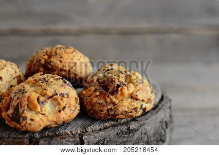 Homemade baked biscuits on a wooden background. Sweet biscuits with walnuts. Closeup