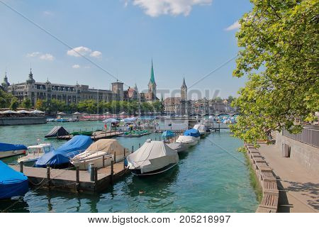 The picture was taken in Switzerland. The picture shows the Limmat river flowing through the city of Zurich.