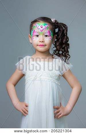 beautiful little girl with a painted face. face painting