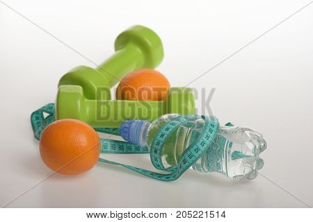 Dumbbells In Bright Green Color, Water Bottle, Measure Tape, Fruit