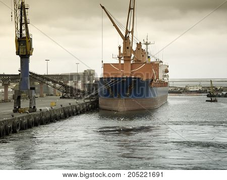Cargo ship docked at at the port of Walvis Bay Namibia