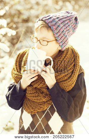 Small Boy With Cup In Winter Outdoor