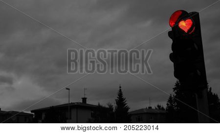 A traffic lights with red hearth in Akureyri city, Iceland