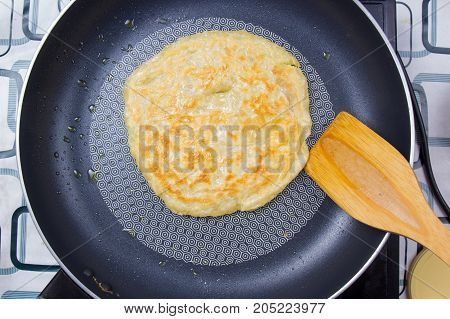 Chef cooking roti in the pan home mate style / Cooking green curry concept