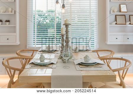 Wooden table and chair in vintage dinning room at home. Interior of dinning room at home.