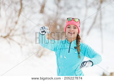 Young Girl Tosses Snowball