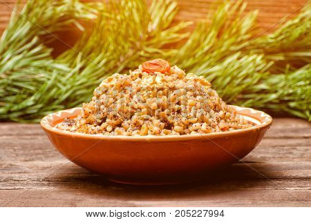 Dish With Kutia. Traditional Christmas Treat Of The Slavs On Christmas Eve. Fur-tree Branch On A Woo
