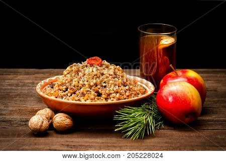 Plate With Traditional Christmas Treat Slavs On Christmas Eve. Compote, Spruce Branch, Apples. Black