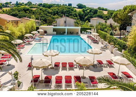 luxurious hotel swimming pool in Numana aerial view (Numana Italy 25 Jul 2017)