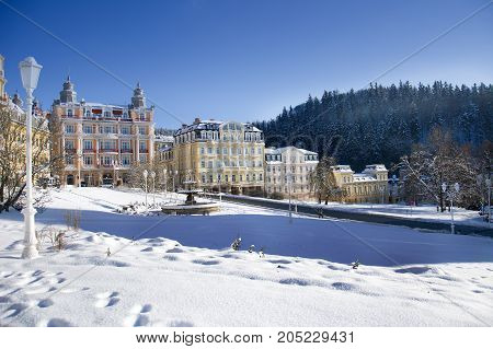 Goethe square in Marianske Lazne (Marienbad) with snow - sunny winter day in the small west bohemian spa town - Czech Republic