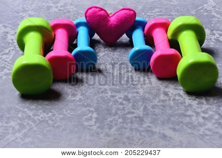 Barbells In Different Colors And Heart Placed In Pattern, Closeup