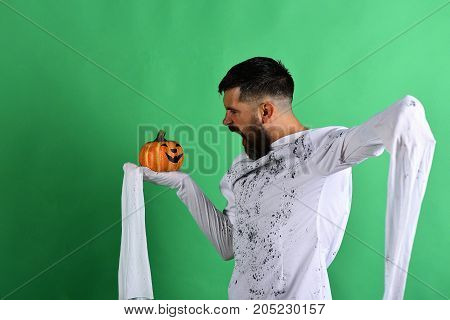 October Time And Spooky Holiday Concept. Man With Mad Face