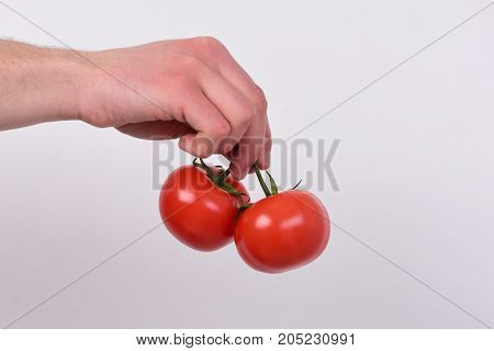 Health And Nutrition Concept. Tomatoes Placed On Light Grey Background.
