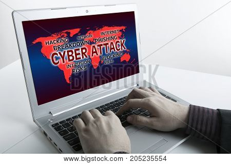 human fingers on the Tablet PC with inscription cyber attack