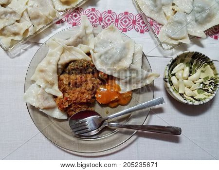Stuffed Dumplings And Sautéed Cabbage.